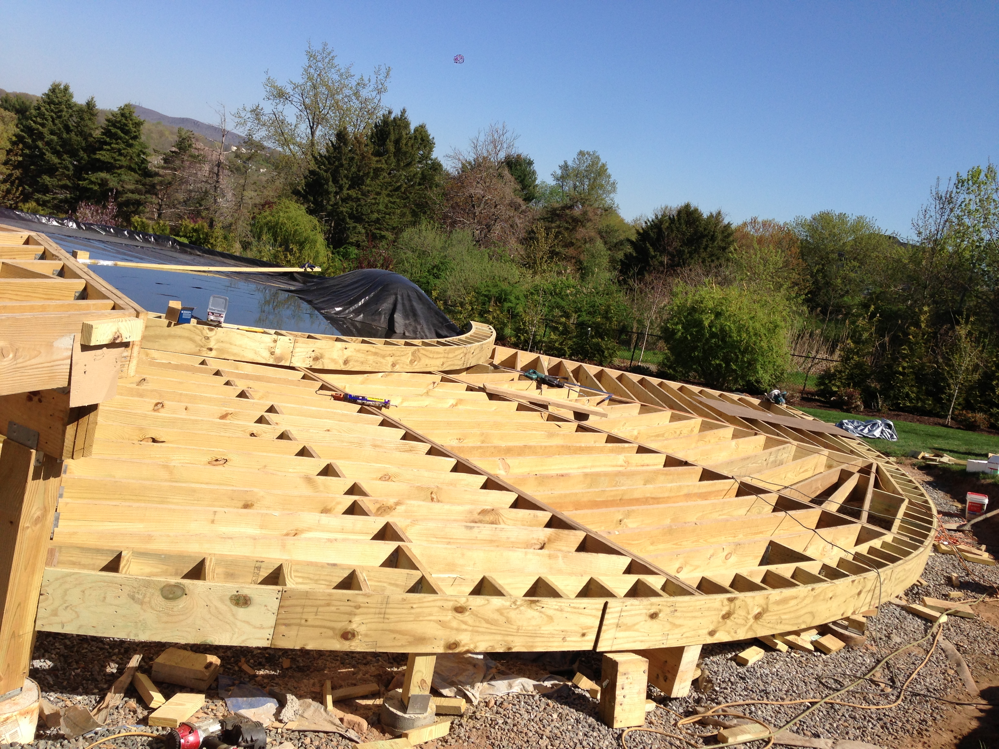 PT Frame for Round Pool Deck, custom laminated PT beams curved.